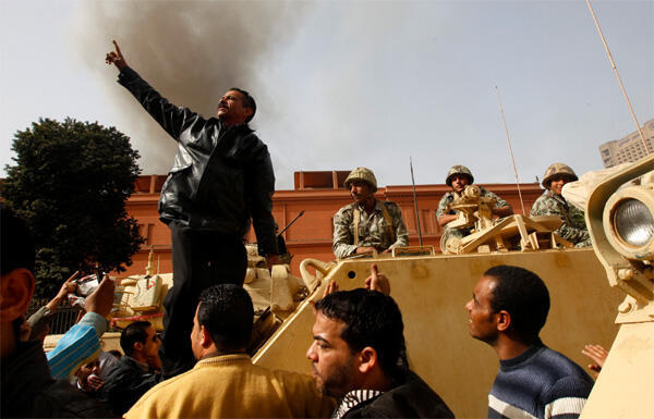 Protesters cheer on the army in central Cairo