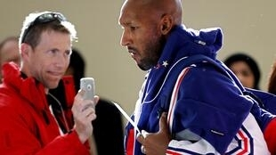 France's national soccer team player Nicolas Anelka arrives at George airport, near Cape Town