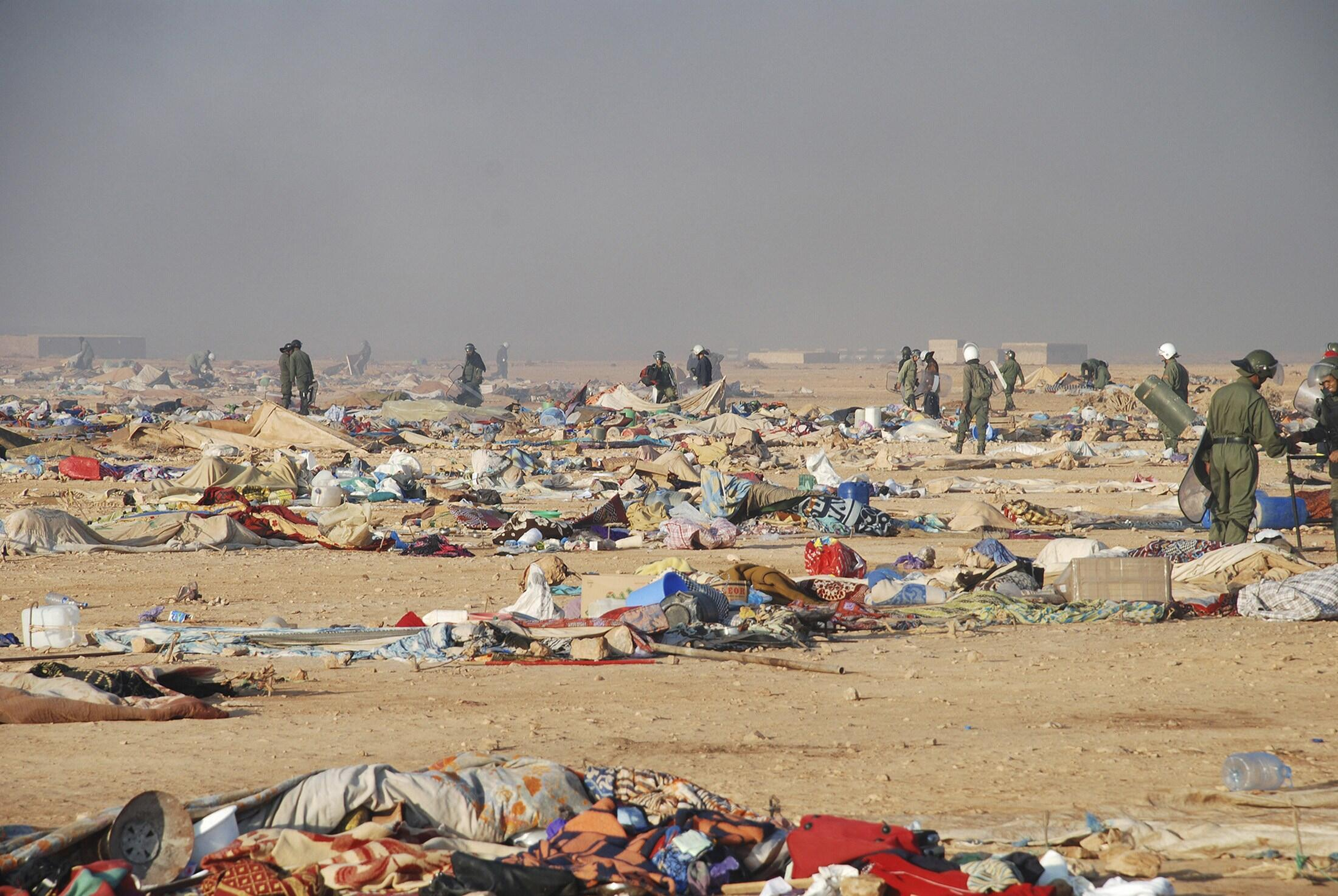 Moroccan security forces break up the tent camp on the outskirts of Western Sahara's capital, Laayoune, on 8 November, 2010