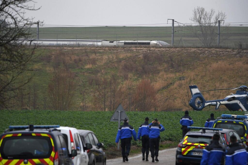 Gendarmes arrive near the site where a high-speed TGV train locomotive derailed close to Inhenheim early on March 5, 2020 while travelling from the eastern city of Strasbourg to Paris.