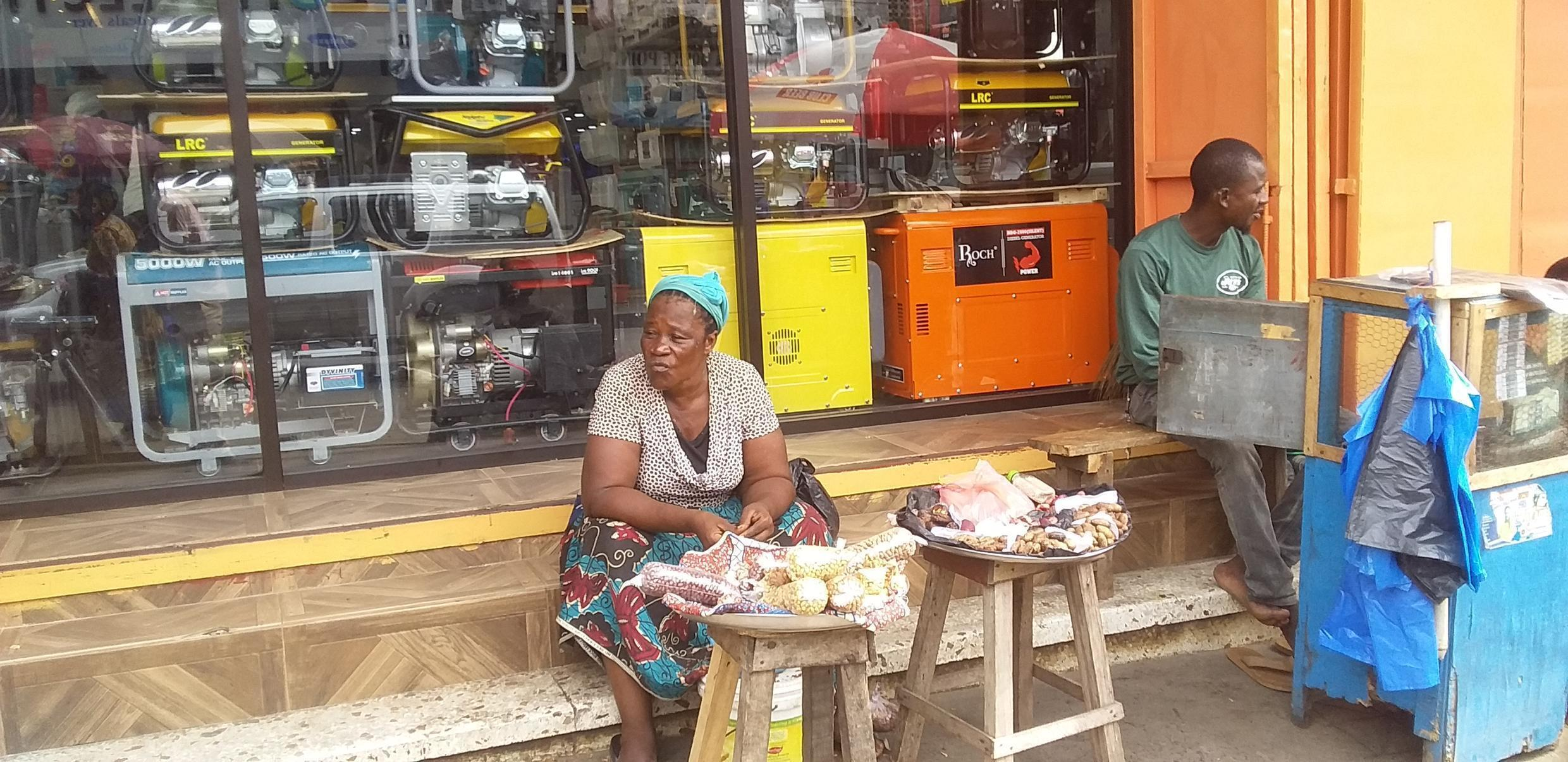 Miatta Sheriff, 47, groundnut seller in Liberia's capital Monrovia, says that she has experienced a downturn in customers.