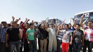 Des volontaires ralliés à l'armée irakienne afin de combattre les militants de l'EIIL, le 22 juin 2014 à Bagdad.