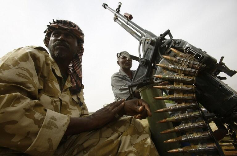 Sudanese paramilitary forces display weapons they say they captured from Justice and Equality Movement group, Nyala, south Darfur, 3 May 2015.