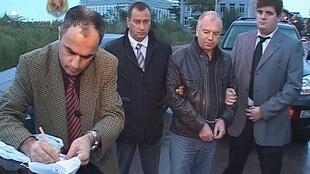 Police officers detain Piotr Davrishadze, who is accused on spying for Russia, in Batumi