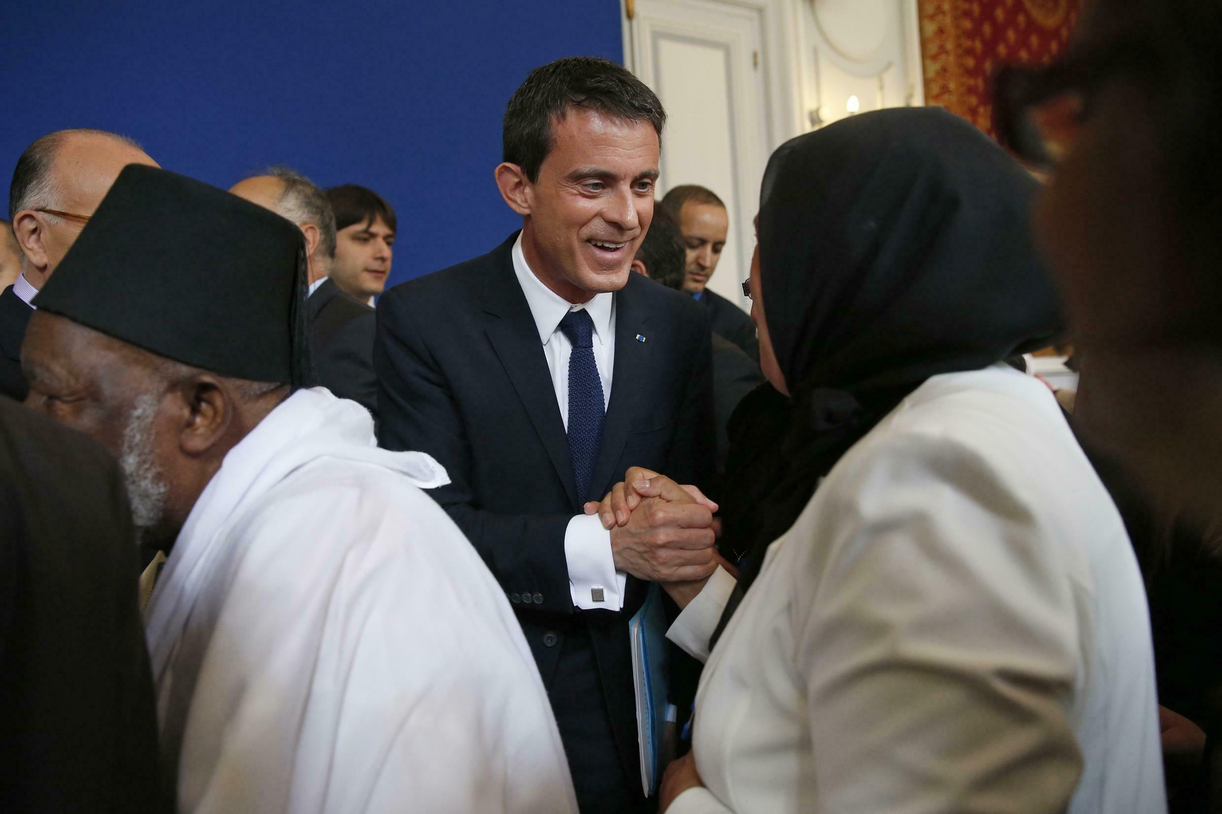 French Prime Minister Manuel Valls meets Latifa Ibn Ziaten, the mother of one of the soldiers killed by Mohamed Merah