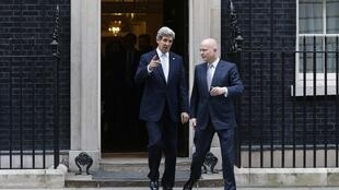 U.S. Secretary of State John Kerry (L) and Britain's Foreign Secretary William Hague leave Number 10 Downing Street in London, 25 February, 2013