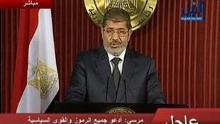 Presidente Mohamed Mursi durante pronunciamento na televisão.