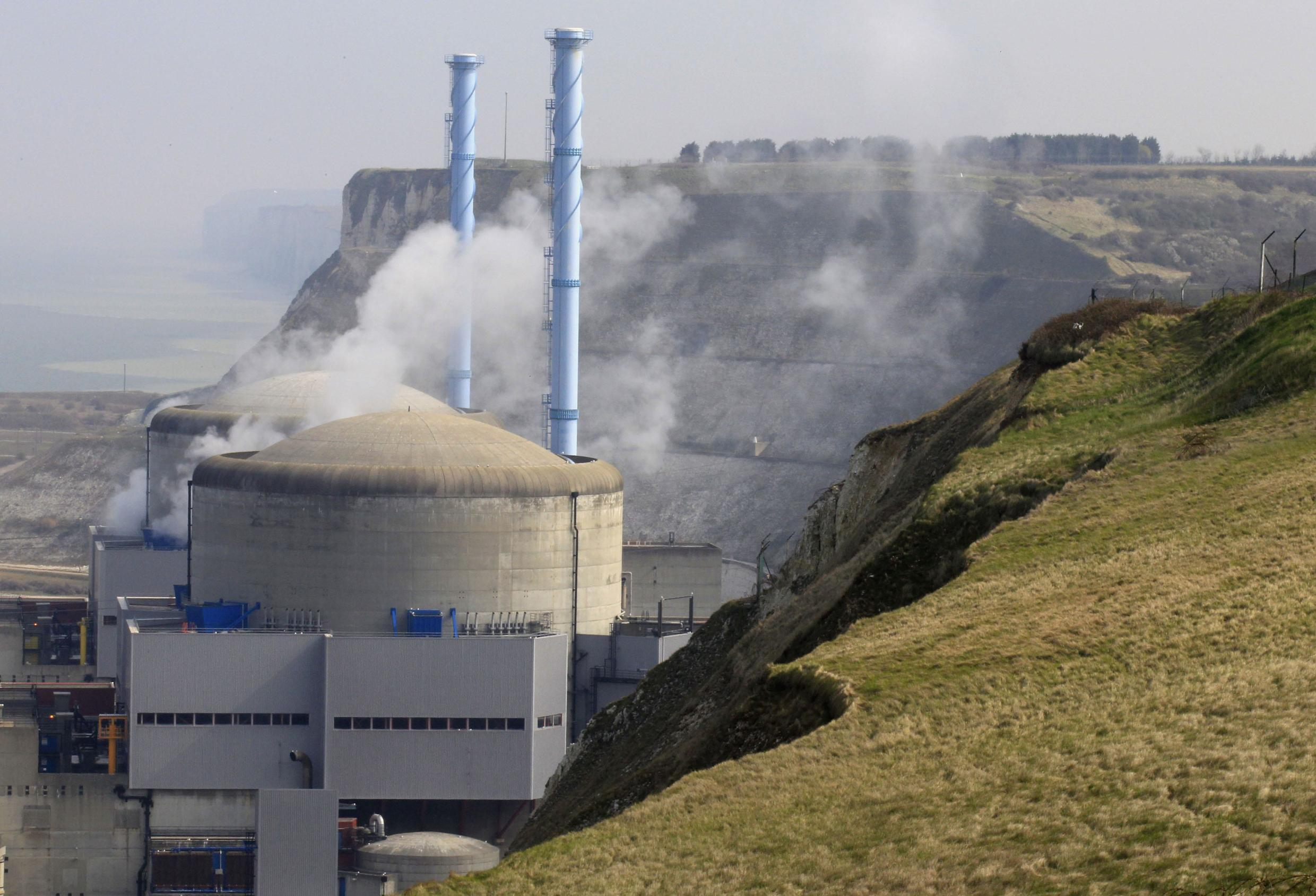Steam rises from the number 2 nuclear reactor after a cooling system water leak in Penly