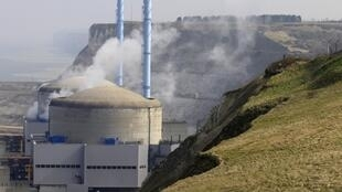 Steam rises from the number two nuclear reactor after a cooling system water leak in Penly