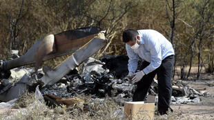 Argentine experts examine the wreckage at the scene of the crash on Tuesday 10 March