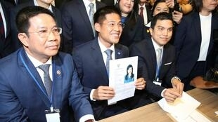Thai Raksa Chart party leader Preechapol Pongpanich, holds up application of candidate for Prime Minister, Thailand's Princess Ubolratana Rajakanya Sirivadhana Barnavadi, at the election commission office in Bangkok, Thailand February 8, 2019.