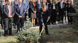President Emmanuel Macron plants a tree at the Tsitsernakaberd Armenian Genocide Memorial in Yerevan.