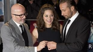 Director Jacques Audiard, Marion Cotillard and Matthias Schoenaerts attend the premier of Rust and Bone at the festival