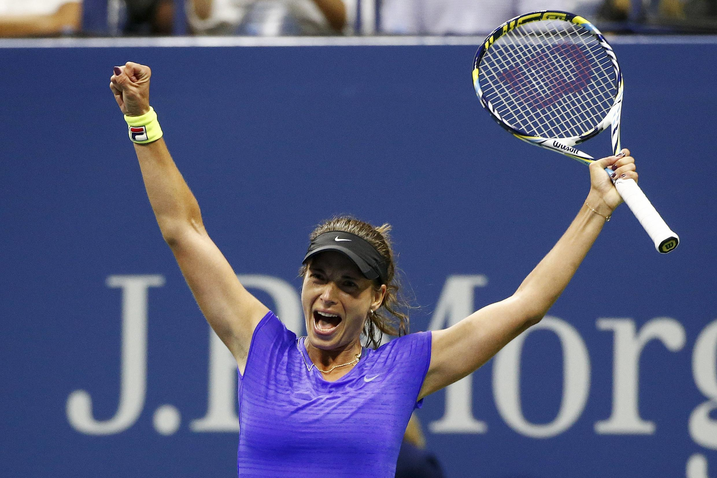Petra Cetkovska of Czech Republic celebrates her win over Caroline Wozniacki of Denmark during their second round match at the US Open.