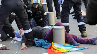 Geneviève Legay, 73, lies injured during a Yellow Vest protest in central Nice.
