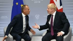 Britain's Prime Minister Boris Johnson next to European Council President Donald Tusk at the G7 Summit in Biarritz, France le 25 August 2019.