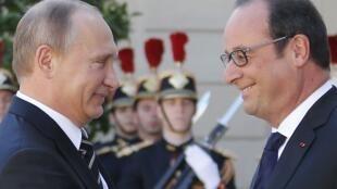 俄羅斯總統普京(左)與法國總統奧朗德在愛麗舍宮