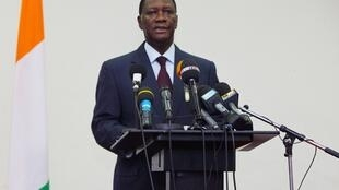 Alassane Ouattara, at a press conference outside the Hotel du Golf, his current residence, in Abidjan on December 24, 2010.