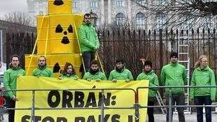 "Greenpeace protestors demonstrate against Viktor Orban's plans to expand the Hungarian nuclear power plant ""Paks""."
