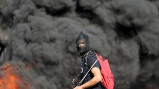 A Palestinian protester at an Israeli checkpoint in Ramallah.