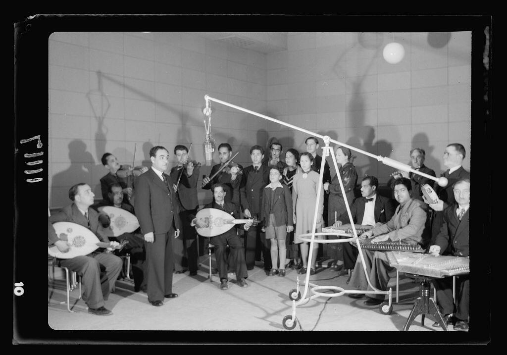 Arab musicians with girl and boy soloists at microphone at PBS studio
