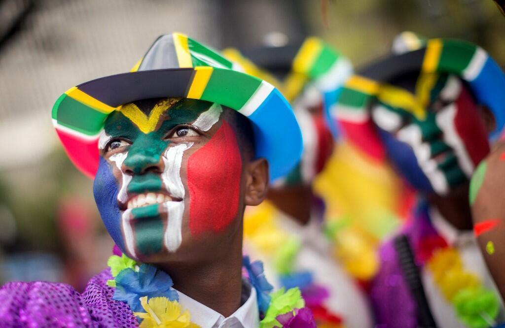 Des hommes peints au couleur du drapeau sud-africain lors d'un festival culturel à Durban, en 2017.