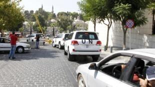 Le cortège de véhicules des experts de l'ONU sur les armes chimiques à leur arrivée à Damas, le 26 août 2013.