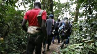 Wapiganaji wa kundi la waasi wa kihutu la FDLR, katika moja ya misitu ilioko mashariki mwa Jamhuri ya Kidemokrasia ya Congo, mwaka 2009.