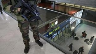 Soldiers patrol Charles de Gaulle ariport as security is tightened following Brussels attacks