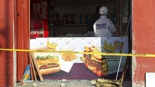 A police investigator inspects the scene after an attack on a kebab restaurant near el Houda mosque in Villefrance-Sur-Saône