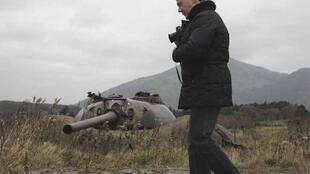 Russian President Dmitry Medvedev take pictures during his visit to Kunashiri Island