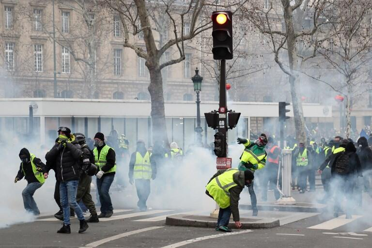 Protesters throw tear gas canisters back at police at Place de la Republique in Paris, 2 February 2019.