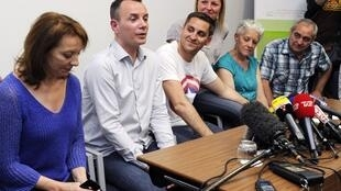 Vincent Autin (2nd L) and Bruno Boileau (centre) at a press conference with families in Montpellier Tuesday