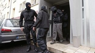 French special police escort a suspect from a residential building in the Meinau suburb of Strasbourg