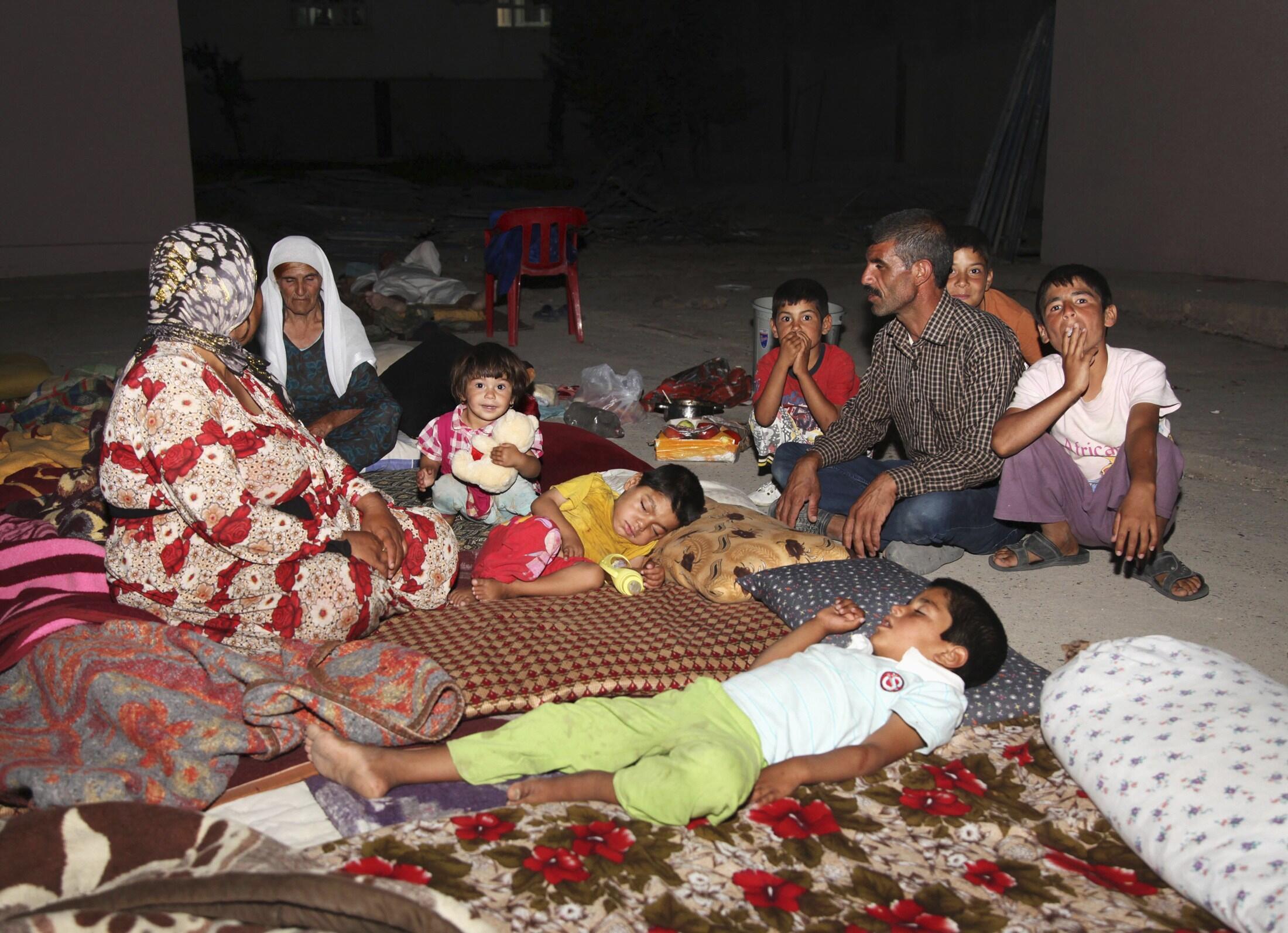 Иракские езиды, скрываясь от джихадистов, которые захватили город Синджар, нашли убежище в провинции Дохуе, 9 августа 2014 г.