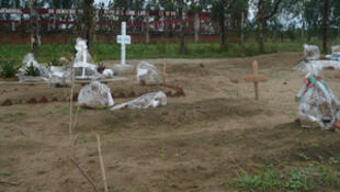 Graves of victims of the 18 September, 2011 Gatumba attack in the foreground