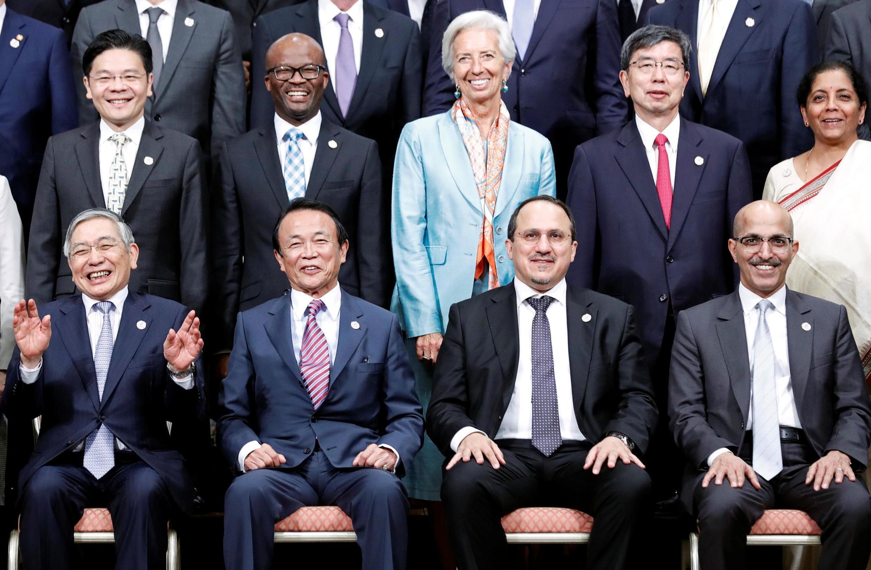 Bank of Japan Governor Haruhiko Kuroda, Japan's Finance Minister Taro Aso, Saudi Arabia's Monetary Authority Governor Ahmed Alkh