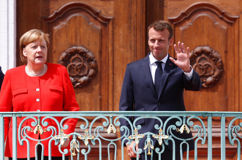 French President Emmanuel Macron (right) and German Chancellor Angela Merkel at the Franco-German meeting in Meseberg, Germany on 19 June 2018.