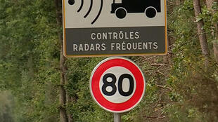 Signs across France indicating new speed limit set at 80 km/h and speed radars in place