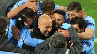 Pep Guardiola (C) celebrates with his Manchester City team in Dortmund