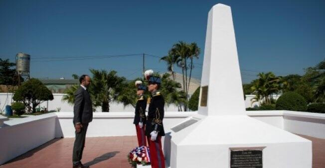 Prime Minister Edouard Philippe (L) lays a wreath at the French memorial in Dien Bien Phu, the battle that spelled the end of France's colonial rule in Indochina