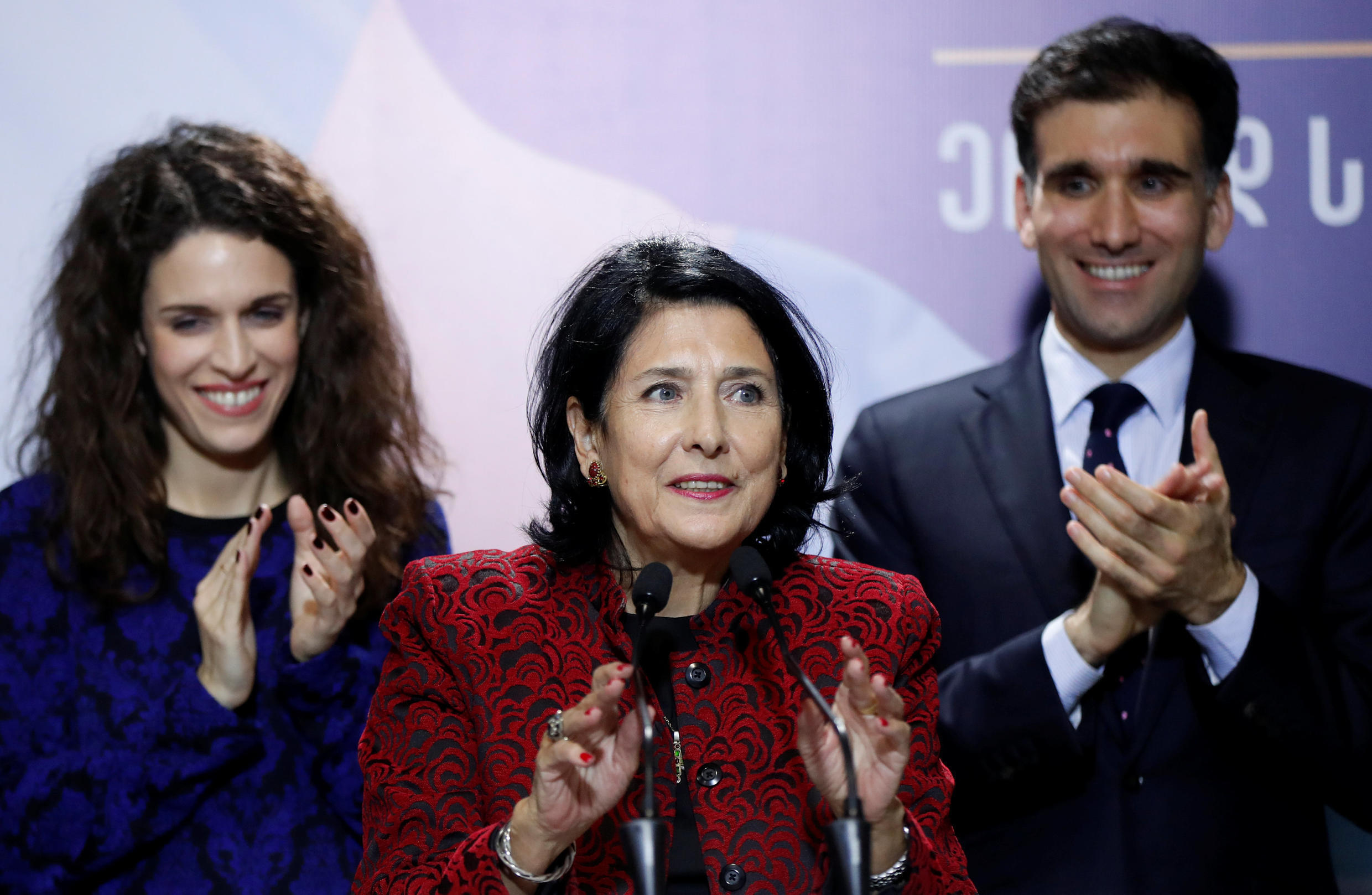 Salome Zurabishvili with her children at her headquarters in Tbilisi after the results were announced
