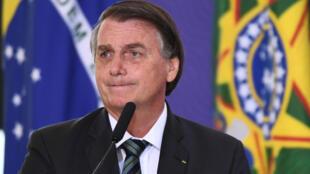 El presidente brasileño Jair Bolsonaro durante el lanzamiento del plan nacional de vacunación contra el nuevo coronavirus Covid-19 en el Palacio Planalto de Brasilia, el 16 de diciembre de 2020.