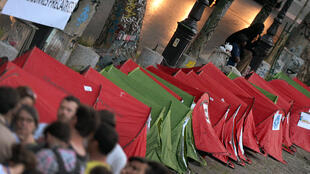 Homeless people's tents during a protest action along the Saint-Martin canal in Paris