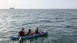 Three migrants attempting to cross the Channel to Britain off the French coast at Calais in August 4, 2018
