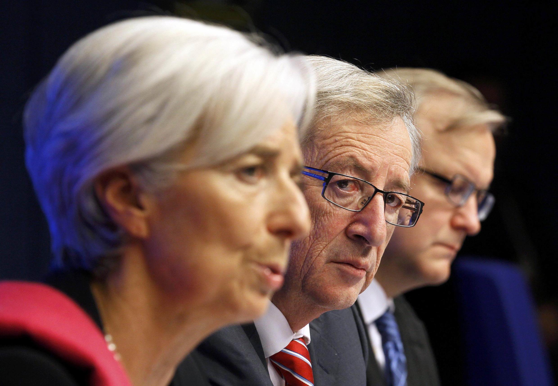 Глава МВФ Кристин Лагард, глава Еврогруппы Жан-Клод Юнкер, еврокомиссар по финансам Олли Рен. Брюссель, 21 февраля 2012.