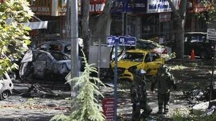 Turkish police bomb disposal experts at the site of the blast in central Ankara.