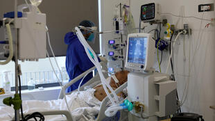 A patient suffering from Covid-19  is treated at the intensive care unit of a hospital in the Lebanese capital Beirut