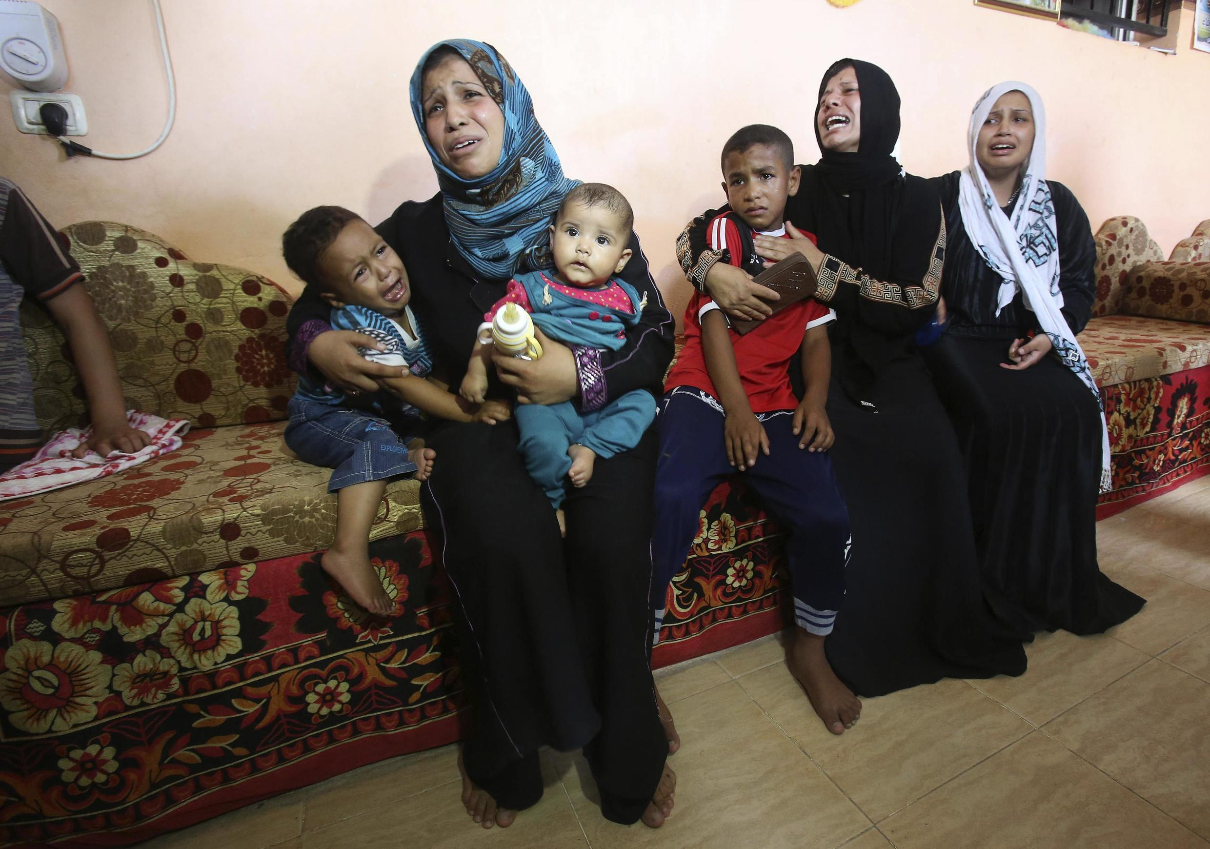 A Palestinian family mourns a four-year-old killed on Sunday