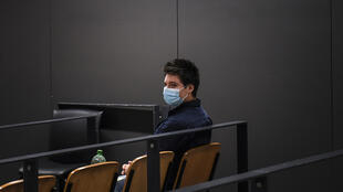 Portuguese whistleblower Rui Pinto waits for the start of his trial in Lisbon